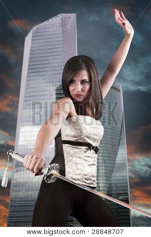 Beautiful girl in a business center with a katana. Angry
