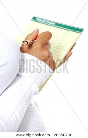 Pregnant woman taking notes in a diary - diary closeup, zoom in on the hand, isolated on a white background.