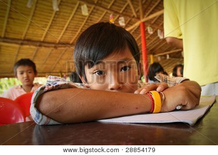 KO CHANG, THAILAND - JANUARY 6: Unknown children in lesson at school by project Cambodian Kids Care to help deprived children in deprived areas with education, on January 6, 2012 in Ko Chang, Thailand