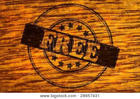 Free stamp on wooden background