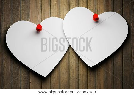 Blank paper hearts on wooden background