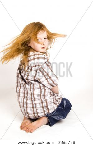 Little Girl Swinging Her Hair
