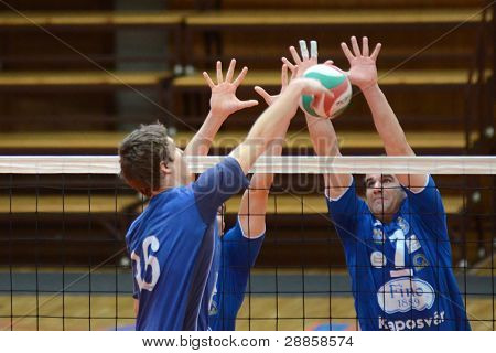 KAPOSVAR, HUNGARY - JANUARY 8: Andras Geiger (R) in action at a Hungarian volleyball National Championship game Kaposvar vs. Dag, on January 8, 2012 in Kaposvar, Hungary.