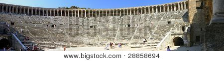 Aspendos, Turkey - September 04, 2008: Autumn Day. Peoples Walk In The Old Greek Amphitheater Aspend