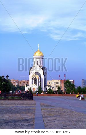 Moscow, Russia - June 26, 2010: Summer Day. Peoples Walk Near The St. Georgy (victorious) Cathedral