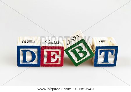 Debt word made by letter blocks