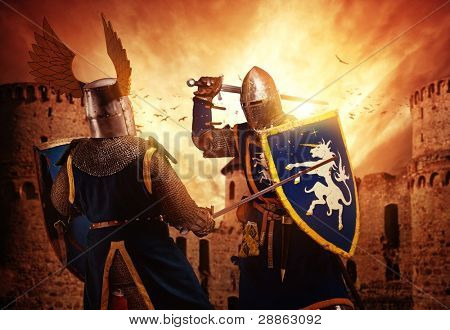 Two knights fighting against medieval castle.