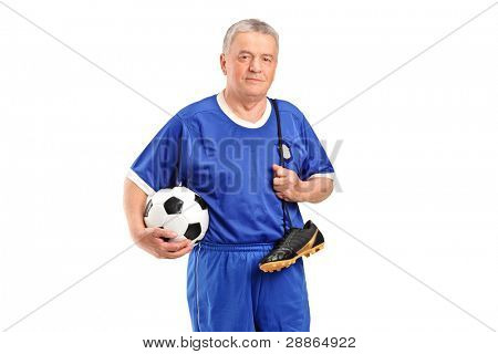 A senior wearing a sport wear holding a soccer shoes and football isolated on white background