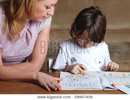 Mother helps her son to do homework