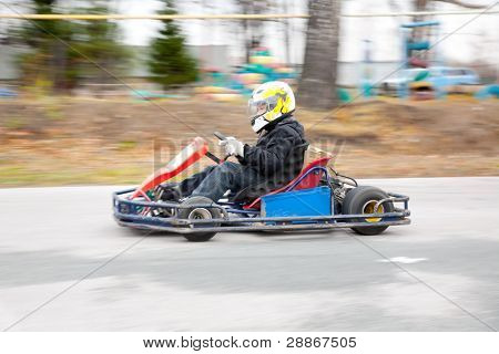 young boy raced on sport kart