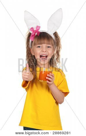 Portrait of happy little girl with carrot juice giving you thumbs up over white background