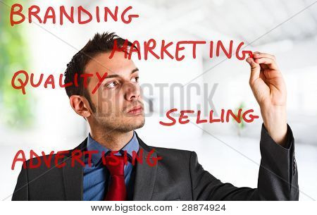 Friendly businessman writing on the screen