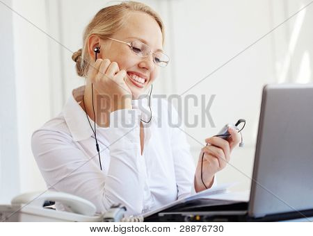 Portrait of a smiling business woman working on her desk