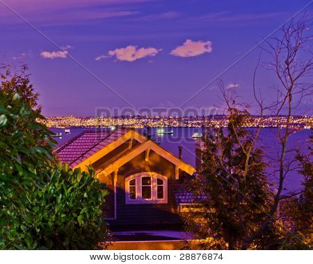 Fragment of a luxury house over fantastic night ocean view in West Vancouver, Canada.