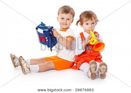 Children with toys in the studio. Isolated on a white background