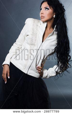 Sexy fashionable mulatto woman on black background