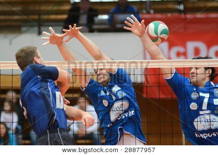 KAPOSVAR, HUNGARY - JANUARY 8: Alpar Szabo (R) in action at a Hungarian volleyball National Championship game Kaposvar vs. Dag, on January 8, 2012 in Kaposvar, Hungary.