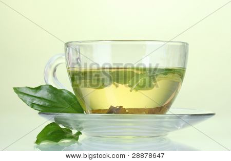 green tea in transparent cup with lime