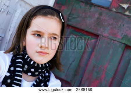 Tween By A Dilapitated  Door