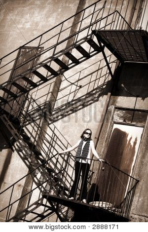 Tween On A Fire Escape