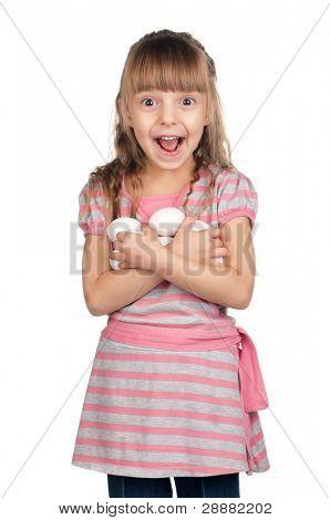 Surprised little girl holding eggs over white background