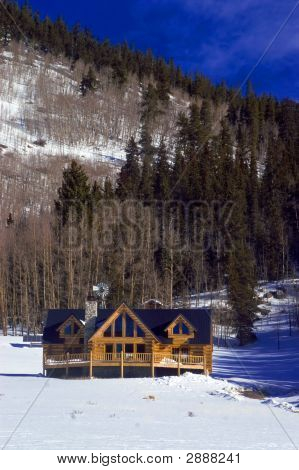 Colorado Mountain Log Home In Snow
