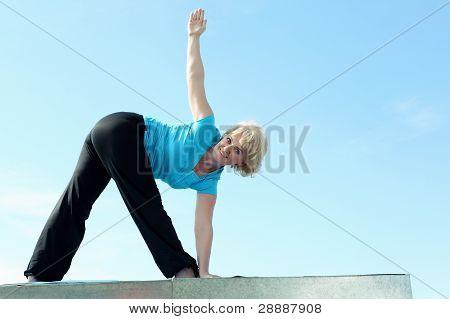 Portrait of a senior Woman tun yoga