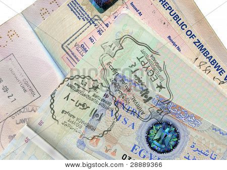Passports  with Egypt and Zimbabwe visas and border stamps