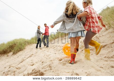 Family having fun on beach vacation