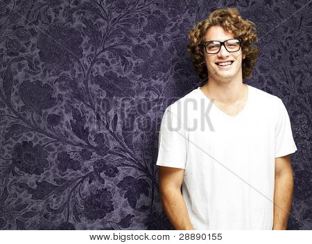 portrait of young man smiling against a vintage background