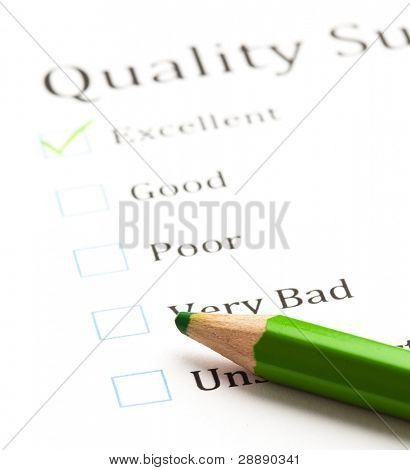 evaluation check boxes and green pen
