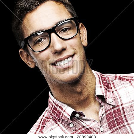 portrait of young man with shirt and glasses over a black background