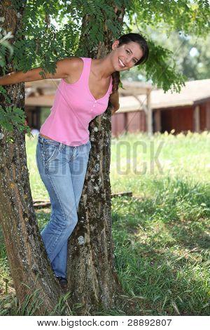 dark-haired woman in garden