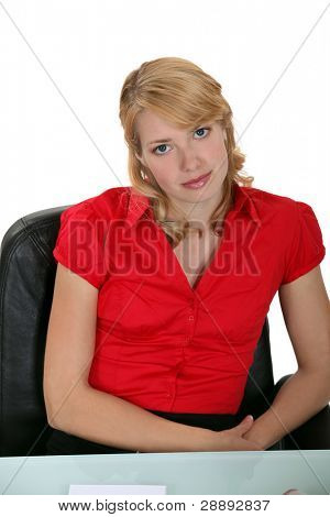Smart woman sitting in a leather chair