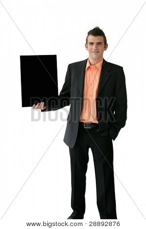 Confident young salesman stood with placard