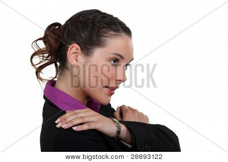 Businesswoman suffering from shoulder pain
