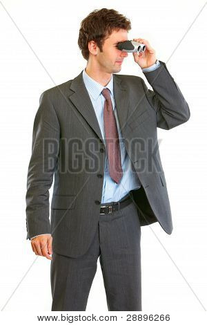 Modern Businessman Looking Through Binoculars In Corner