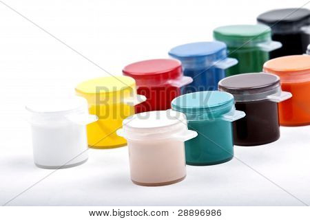 Different colours of paint on a white background