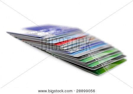 Stack of plastic credit cards, isolated on white background