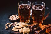 Beer And Snacks. Bar Table. Restaurant, Pub, Food Concept. Craft Lager Drink, Salted Nuts And Breade poster