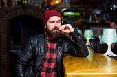 Bar Is Relaxing Place To Have Drink And Relax. Man With Beard Spend Leisure In Dark Bar. Brutal Lone poster