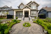 Main Entrance Of Residential House With Rounded Paved Pathway Over Front Yard On Cloudy Day. Luxury  poster