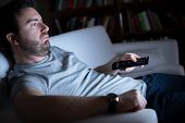 Lazy Man Watching Television At Night Alone poster