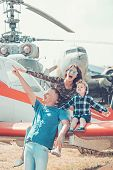 Flying On Wings Of Love. Air Tour And Travel. Woman And Man With Boy Child At Helicopter. Happy Fami poster