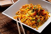 stock photo of chinese wok  - Chinese noodles with shrimps on a bamboo table - JPG