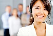 stock photo of telephone operator  - Female customer support operator with headset and smiling - JPG