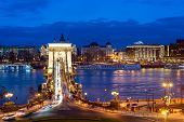 Nineteenth Century Chain Bridge (szechenyi Lanchid) And Budapest Cityscape At Night. Budapest, Hunga poster