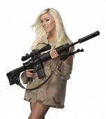 Attractive woman modelling with high power fire gun weapon