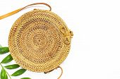Fashionable Handmade Natural Organic Rattan Bag And Green Twig On White Background. Ladies Bag Made poster