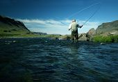 pic of fly rod  - fisherman seen from a worms view - JPG